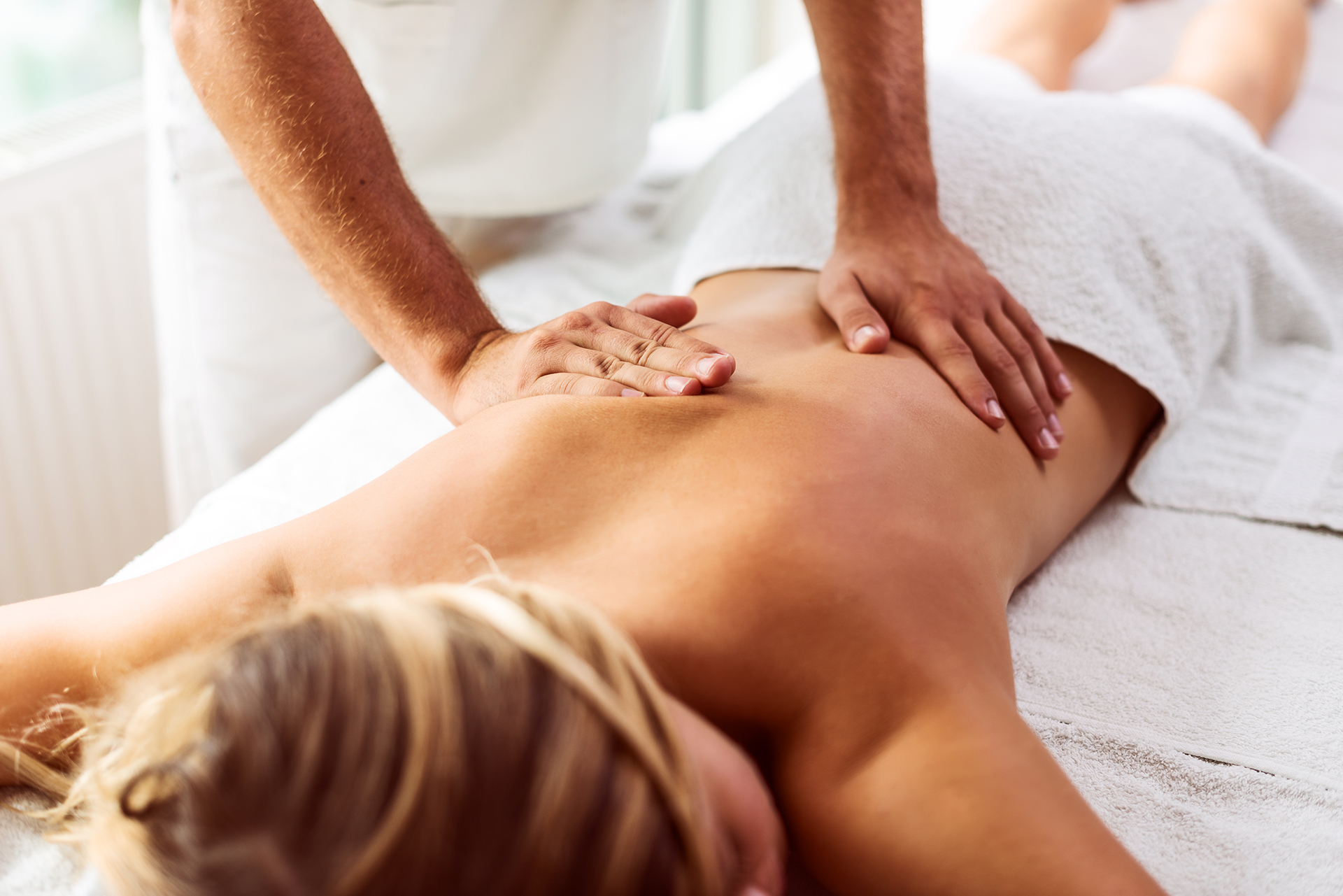 Woman receiving a massage in a towel