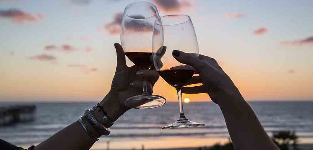 EDS Blog - Sip Into Summer - Toasting the Sunset