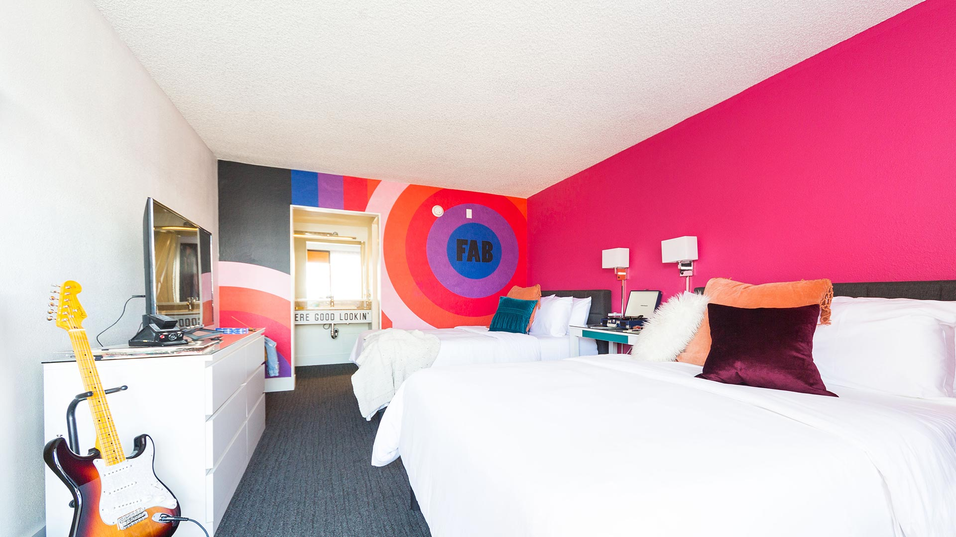 Rambler: view of two queen beds with RAD wall graphic in view